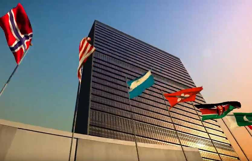 tall urban building with global flags.