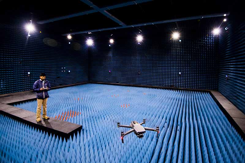 student flying drone in indoor ummanned aircraft facility