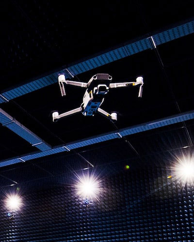 image of a drone and three lights