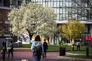 student walking on centennial common at Northeastern